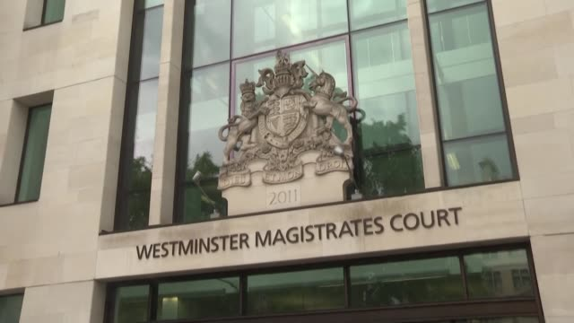 julian assange's supporters protest in front of westminster magistrate court in london where the wikileaks founder is heard via video link from prison - john pilger stock videos & royalty-free footage