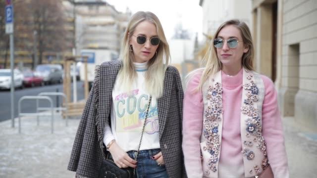 juliane diesner wearing a top chanel white tshirt hm jeans blazer and shoes acne studios chanel bag and sonia lyson wearing bag valentino zara... - maglietta video stock e b–roll