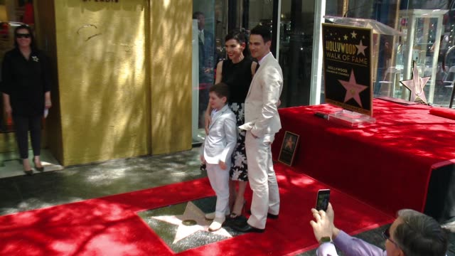 julianna margulies and family at julianna margulies honored with star on the hollywood walk of fame at hollywood walk of fame on may 01, 2015 in... - walk of fame stock videos & royalty-free footage