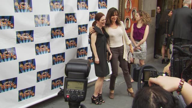 julianne moore and polly draoer at the opening of 'lend me a tenor' arrivals at new york ny - lend me a tenor stock-videos und b-roll-filmmaterial