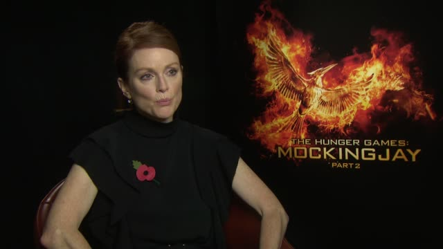 The hunger games mockingjayb getty images interview julianne moore on jennifer lawrence at the hunger games mockingjay part 2 interviews voltagebd Image collections
