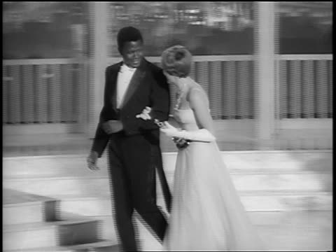 julie andrews taking sidney poitier's arm as they walk offstage at academy awards - julie andrews stock videos & royalty-free footage