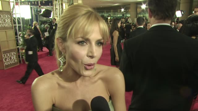 Julie Benz on being on Dexter and it's nomination on who she is rooting for She is wearing Kevin Hall and Jimmy Choos at the 66th Annual Golden Globe...