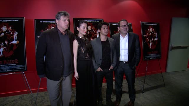"""julie estelle, iko uwais, director gareth evans and guests at """"the raid 2"""" new york screening at sunshine landmark on march 17, 2014 in new york city. - landmark sunshine theater stock videos & royalty-free footage"""