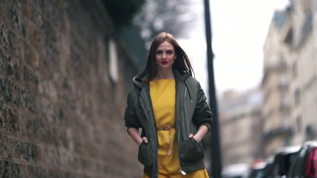 Julie Ianc wears a green khaki bomber jacket a yellow dress outside Elie Saab during Paris Fashion Week Womenswear Fall/Winter 2019/2020 on March 02...