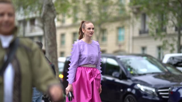 julie ianc wears a light purple longsleeves top, a studded belt, a lustrous hot pink flowing skirt, a glittering black clutch, glittering... - valentino designer label stock videos & royalty-free footage