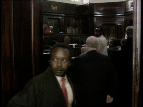 Julie Ward murder case KENYA Nairobi CBV John Ward into courtroom CMS Ward getting into witness box TRACK TGV Court in session