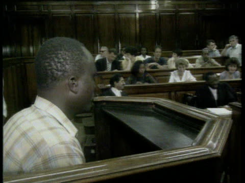 'Not guilty' verdict INT Accused in court as court oficials in b/g TX 25292LMS Officials seated in court ITN