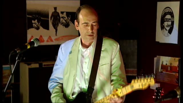 julien temple film about joe strummer released; mick jones and tony james playing guitars together in the studio as the band carbon/silicon - julien temple stock videos & royalty-free footage