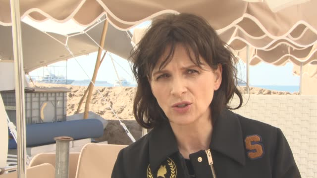 juliette binoche on the importance of changing attitues in the film industry at 'we do it together' interview and photocall on may 15, 2016 in... - juliette binoche stock videos & royalty-free footage