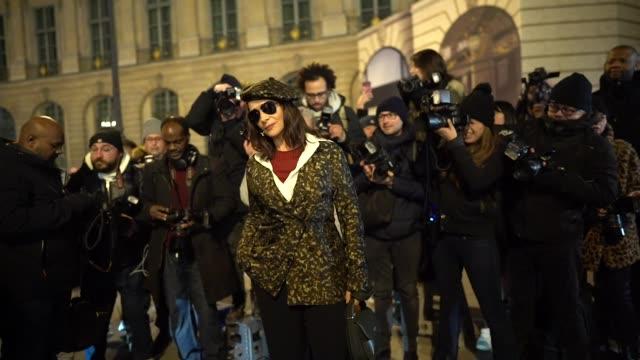 juliette binoche wears a beret hat, sunglasses, a red wool pullover, a navy blue long coat, a leopard print jacket, black flare pants, a green bag,... - juliette binoche stock videos & royalty-free footage