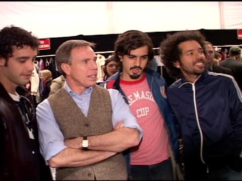 stockvideo's en b-roll-footage met julio briceno, tommy hilfiger, armando figueredo, & jose luis pardo standing backstage at mercedes benz fashion week tent posing for press,... - pardo