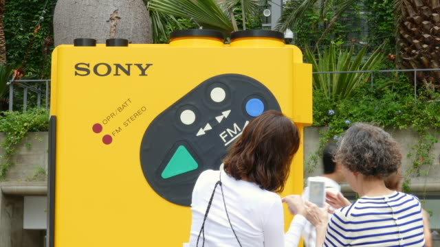 july 08 tokyo japan a huge portable audio player ''walkman wmf5'' on display at ginza sony park sony celebrates the 40th anniversary of its walkman... - portable stereo stock videos & royalty-free footage