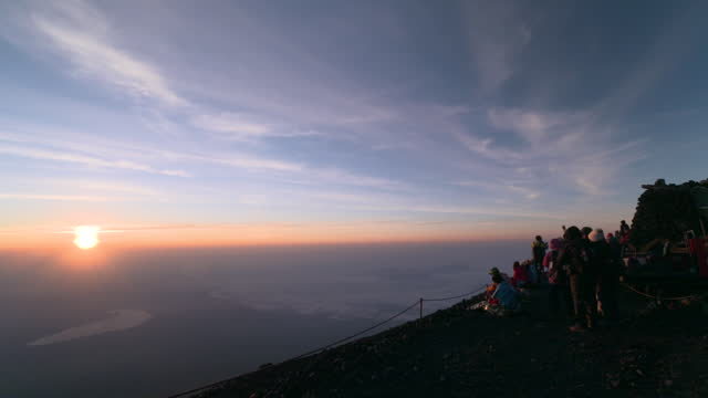 july 10 many climbers watching sunrise from mt fuji - mt fuji stock videos & royalty-free footage