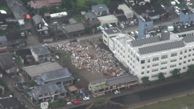 rescue workers on friday continued to search for 16 people missing on the southwestern japan main island of kyushu following torrential rain since... - fukuoka prefecture stock videos & royalty-free footage