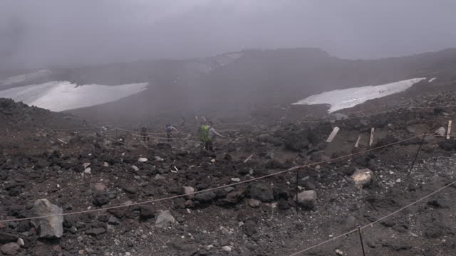july 11 climbers near the summit of mt fuji in the fog - mt fuji stock videos & royalty-free footage