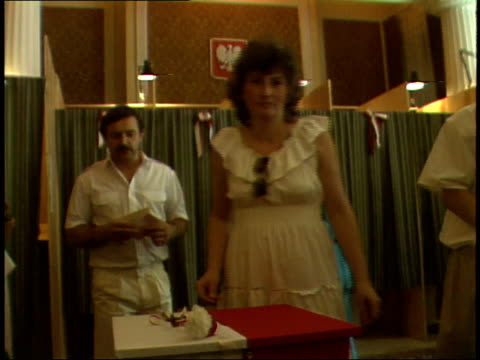 stockvideo's en b-roll-footage met july 12, 1989 voters slipping completed ballots into ballot box decorated with red and white carnations / warsaw, poland - 1980 1989