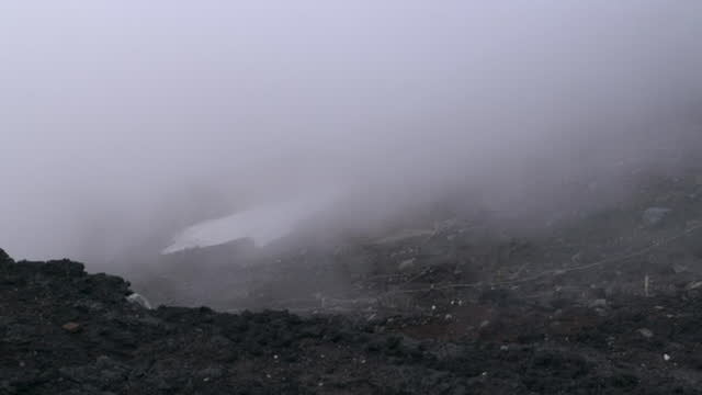july 12 climbing trail near the summit of mt fuji in the fog - mt fuji stock videos & royalty-free footage