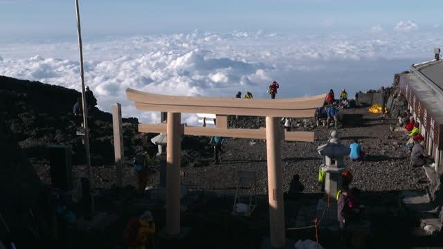 july 12 high-angle view; summit of mt fuji and cloud sea with shrine gate of fujisan hongu sengen taisha oku-no-miya - shinto shrine stock videos & royalty-free footage
