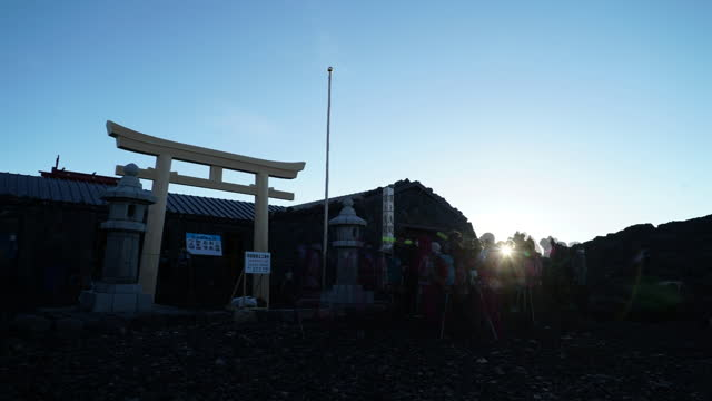 july 12 time-lapse, summit of mt fuji with shrine gate of fujisan hongu sengen taisha oku-no-miya with climbers at dawn - mt fuji stock videos & royalty-free footage