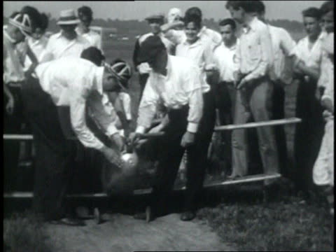july 13, 1931 montage young men flying a large model bi-plane as crowd watches / dayton, ohio, united states - 1931 stock videos & royalty-free footage