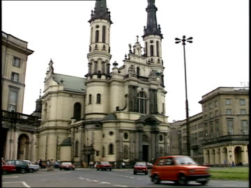 july 14, 1989 traffic flowing on savior square roundabout past church of the holiest savior / warsaw, poland - 1989 stock videos & royalty-free footage