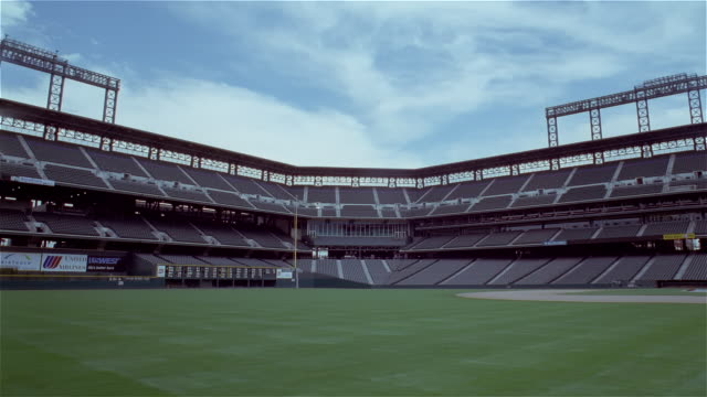 July 14, 1997 Time lapse pan left across field and empty stands at Coors Field / Denver, Colorado