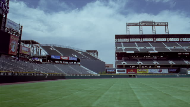 july 14, 1997 time lapse pan right across field and empty stands at coors field / chicago, illinois - denver stock videos & royalty-free footage