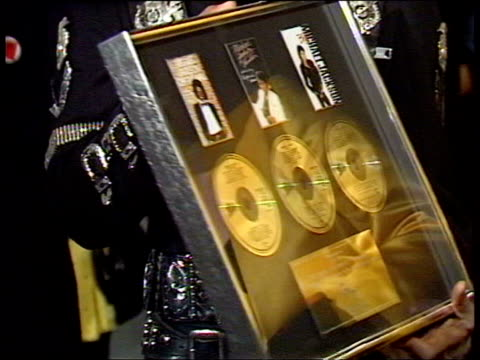 July 16 1988 FILM MONTAGE MS Michael Jackson presenting Princess Diana and Prince Charles with a 'Bad' tour jacket and framed CDs at a Prince's Trust...