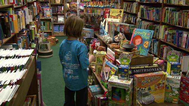 july 16, 2009 children browsing picture books at tattered cover bookstore / denver, colorado, united states - picture book stock videos & royalty-free footage