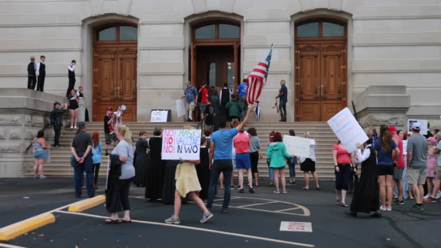 july 19, 2020 - indianapolis, indiana usa: protesters leave a signed banner for the indiana governor on the doors of the indiana statehouse during... - july stock videos & royalty-free footage