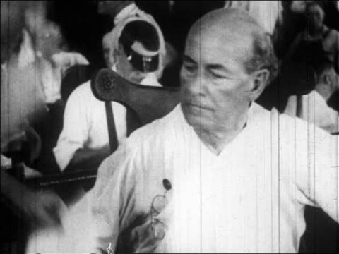 b/w july 1925 close up william jennings bryan sitting listening to man / scopes trial tennessee / news - william jennings bryan stock videos & royalty-free footage