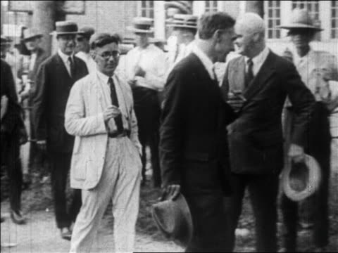 b/w july 1925 men gathering to pose for camera at scopes monkey trial / tennessee / newsreel - 1925 stock videos & royalty-free footage