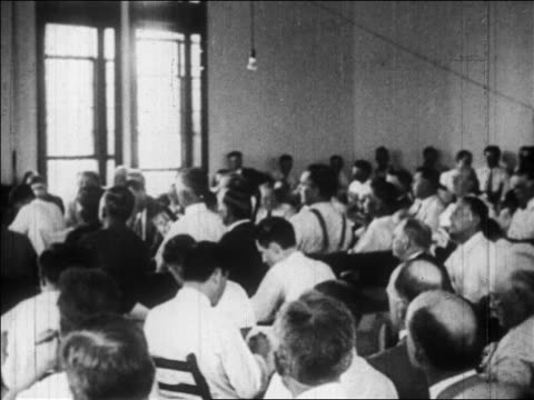 b/w july 1925 rear view pan people with fans in crowded courtroom / scopes trial tennessee / newsreel - 1925 stock videos & royalty-free footage