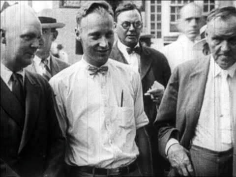 july 1925 two men standing by john t. scopes before trial / tennessee / newsreel - anno 1925 video stock e b–roll