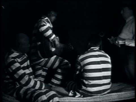 """vídeos y material grabado en eventos de stock de july 1935 leadbelly playing guitar and singing """"good night irene"""" in prison / louisiana, united states - 1935"""