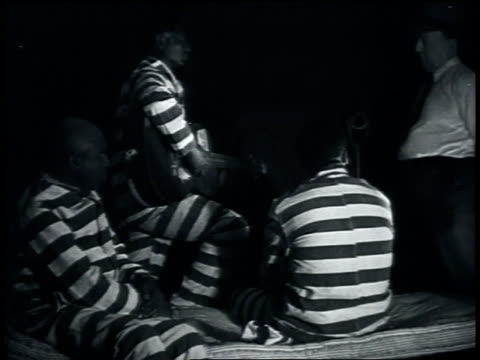 stockvideo's en b-roll-footage met july 1935 leadbelly pleading with john lomax to use his music to get him out of prison / louisiana, united states - 1935