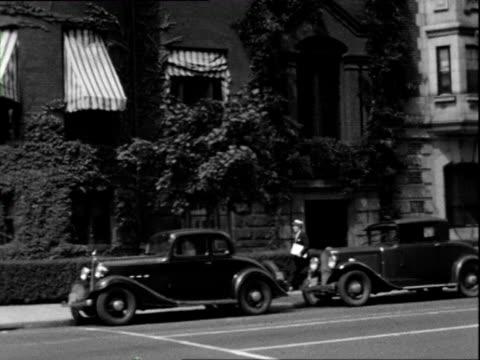 july 1938 b/w ms tu hotel with cars out front / washington dc, usa - 1938 bildbanksvideor och videomaterial från bakom kulisserna