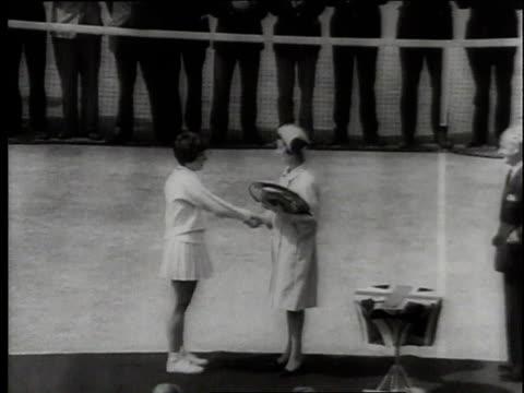 july 1966 montage billie jean moffitt king receiving the trophy at wimbledon / london, united kingdom, united kingdom - ビリー・ジーン・キング点の映像素材/bロール