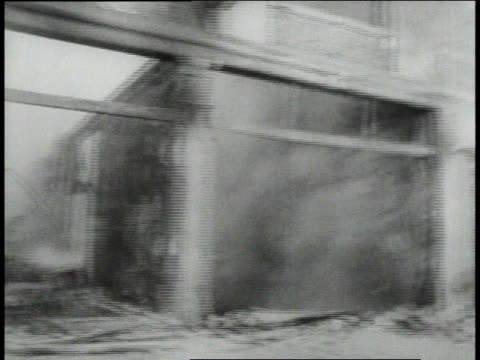 july 1967 montage burned out buildings on a city street in detroit following a race riot, with a voice-over of lyndon johnson's speech / michigan,... - 1967 stock videos & royalty-free footage