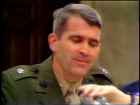 july, 1987 close up oliver north laughs while listening to lawyer then talking during iran-contra hearings - 1987 bildbanksvideor och videomaterial från bakom kulisserna