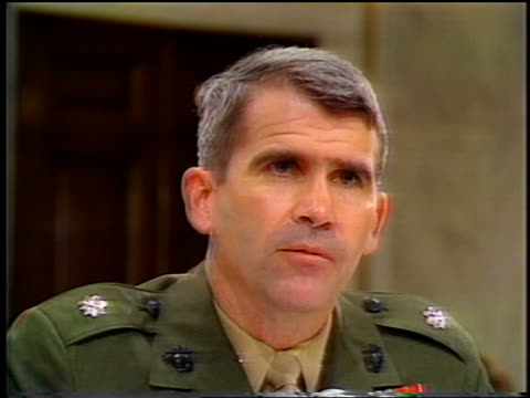 july, 1987 close up oliver north talking during iran-contra hearings - 1987 bildbanksvideor och videomaterial från bakom kulisserna
