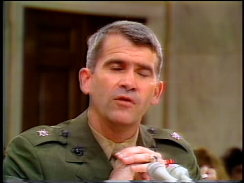 july, 1987 close up oliver north talking + gesturing during iran-contra hearings - 1987 bildbanksvideor och videomaterial från bakom kulisserna