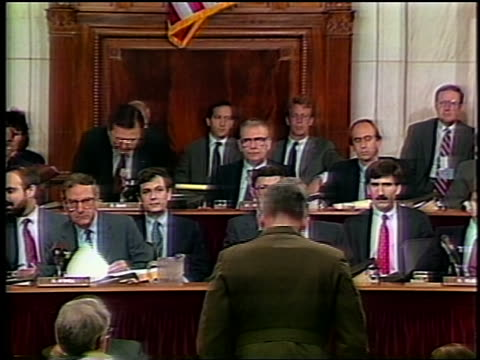july 1987 oliver north daniel inouye sit down after swearing in during irancontra hearing - united states marine corps stock-videos und b-roll-filmmaterial