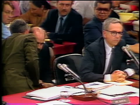july 1987 oliver north sitting next to lawyer talking into microphone during irancontra hearings - gerichtsverhandlung stock-videos und b-roll-filmmaterial