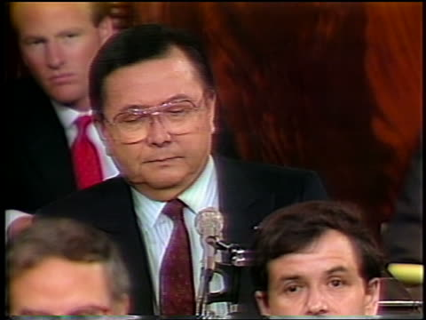 July 1987 Senator Daniel Inouye talking into microphone then standing during IranContra hearings