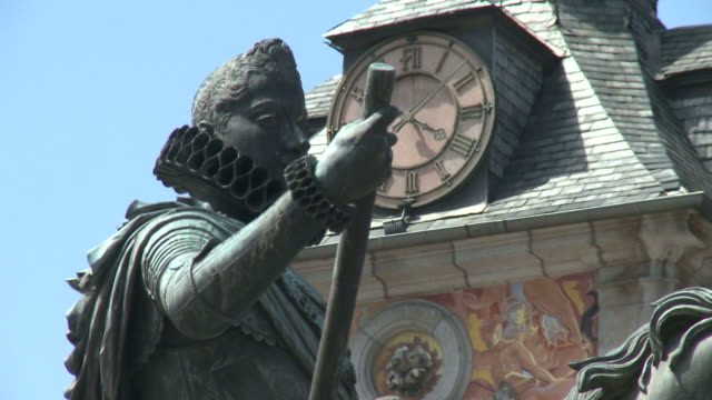 july 2, 2010 statue of king felipe iii with clock in the background / barcelona, spain - monumento video stock e b–roll