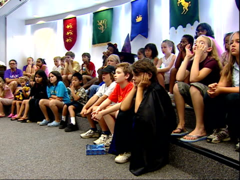 july 20 2007 pan librarian reading harry potter to a group of children at the falls church library / virginia united states - librarian stock videos & royalty-free footage