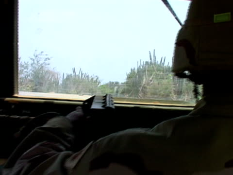 vídeos de stock, filmes e b-roll de july 2005 close up soldier driving down road in humvee/ guantanamo bay - uniforme militar