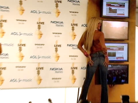 July 2005 Medium shot zoom in scantily clad Anna Nicole Smith appearing for photo op during Live 8/ Philadelphia